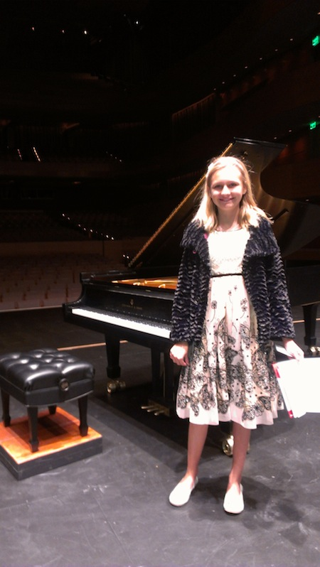 Clara in Hall in front of Steinway concert grand! copy